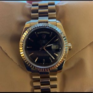 Gold with Onxy (black) dual Rolex Day Date
